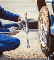 Change a flat car tire on road with Tire maintenance, damaged car tire