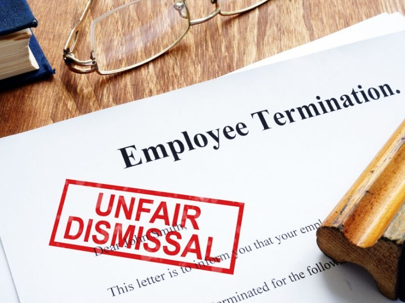 employee termination papers with unfair dismissal stamp